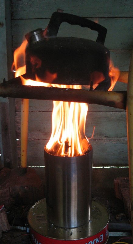 Boiling a kettle over a fire of sticks and bamboo.